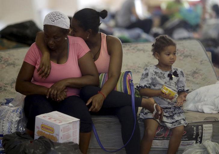 A solidariedade ainda existe e alimenta a esperança - Foto - Ricardo Moraes/06.11.2015/Reuters - reprodução do Balaio do KOstcho
