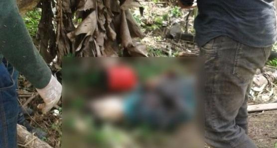 Um dos corpos foi encontrado no mato do assentamento no qual as vítimas tentavam sobreviver. Foto Secretaria de Segurança-MT