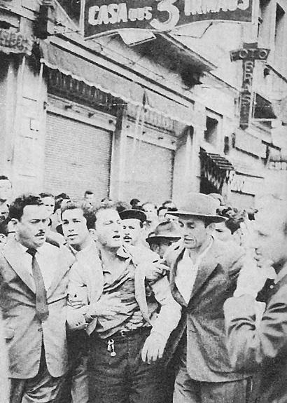 Na foto do Jornal A Gazeta do Povo (PR) no centro, o comerciante Ahmed Najar: disputa com militar por nota fiscal começou a confusão